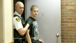 Nicholas Layman, 19, accused of stabbing an 11-year-old boy on a Newfoundland soccer field walks into provincial court in St. John's Friday, Sept. 26, 2014.