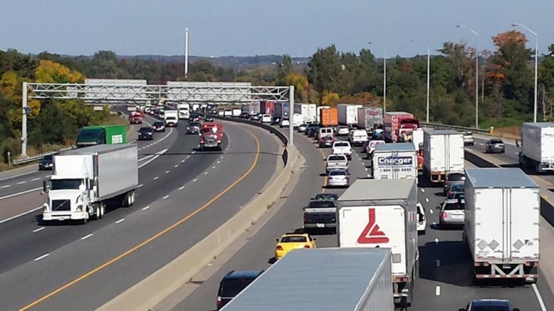 Many transport trucks are visible on Highway 401 westbound between the Highway 24 and Highway 8 exits on Friday, Sept. 26, 2014. (Dan Lauckner / CTV Kitchener)