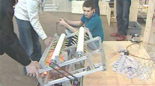 The students designed, built and programmed the robot and spent the weekend putting on the finishing touches.