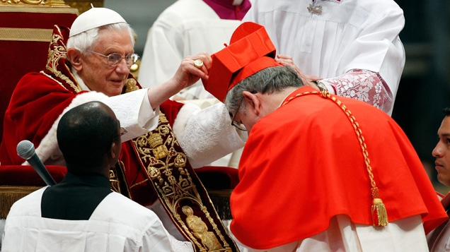 Newly-elected Cardinal, Archbishop of Toronto Thomas Christopher Collins, receives his biretta hat from Pope Benedict XVI during his elevation inside the St. Peter's Basilica at the Vatican, Saturday, Feb. 18, 2012. (AP / Andrew Medichini)