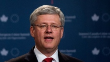 Harper: Canada can't sit on the sidelines