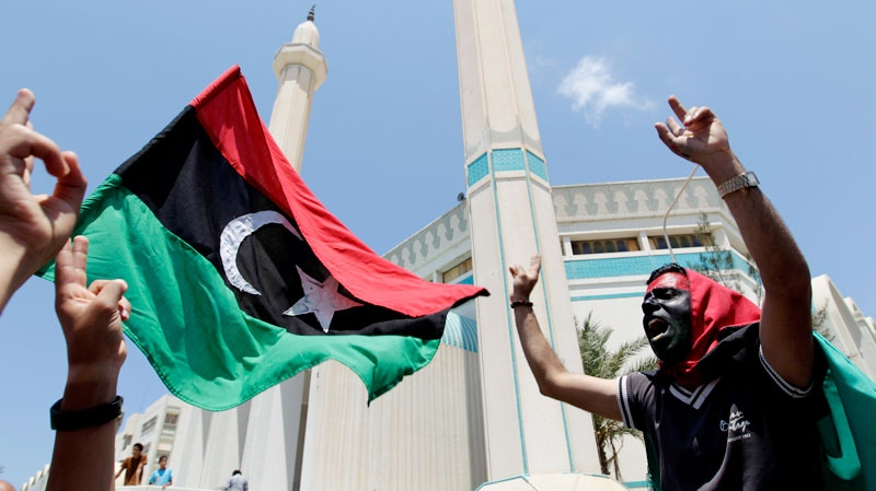 A Libyan protester chants slogans against dictator Moammar Gadhafi during a demonstration following the Friday prayers in Misrata, Libya, on June 17, 2011. (AP / Hassan Ammar)