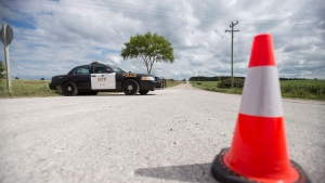 Ontario Provincial Police near Clinton Ont., in this file photo from Sept. 14, 2014. (Geoff Robins / THE CANADIAN PRESS)