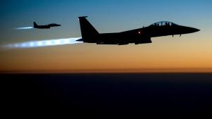 A pair of U.S. F-15E Strike Eagle fighter jets flies over northern Iraq after conducting airstrikes in Syria Tuesday, Sept. 23, 2014. (U.S. Air Force / Matthew Bruch)