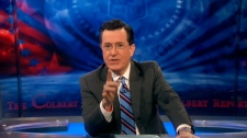 In this image taken from video, Stephen Colbert is seen on the set of his show 'The Colbert Report' in New York, Monday, Feb. 20, 2012.