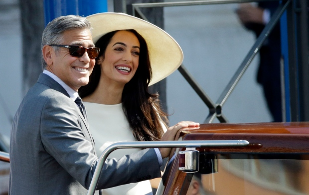 George Clooney and Amal Alamuddin leave Venice's city hall, Monday, Sept. 29, 2014. (AP / Andrew Medichini)