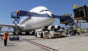 File photo. A Singapore Airlines Airbus 380, Flight 12 from Singapore to Los Angeles, breaks a ribbon in the ceremonial grand opening of the Tom Bradley International Terminal at Los Angeles International Airport Sept. 18, 2013. (AP / Reed Saxon)