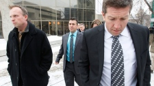 Former hockey players Todd Holt, centre, and Sheldon Kennedy, right, walk out of court at the Graham James sentencing hearing in Winnipeg, Wednesday, Feb. 22, 2012. (John Woods / THE CANADIAN PRESS)