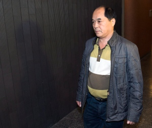 Diran Lin, father of victim Jun Lin, walks to the courtroom for the murder trial of Luka Rocco Magnotta in Montreal on Monday, Sept. 29, 2014. (Ryan Remiorz / THE CANADIAN PRESS)