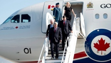 Harper under fire for plane trip