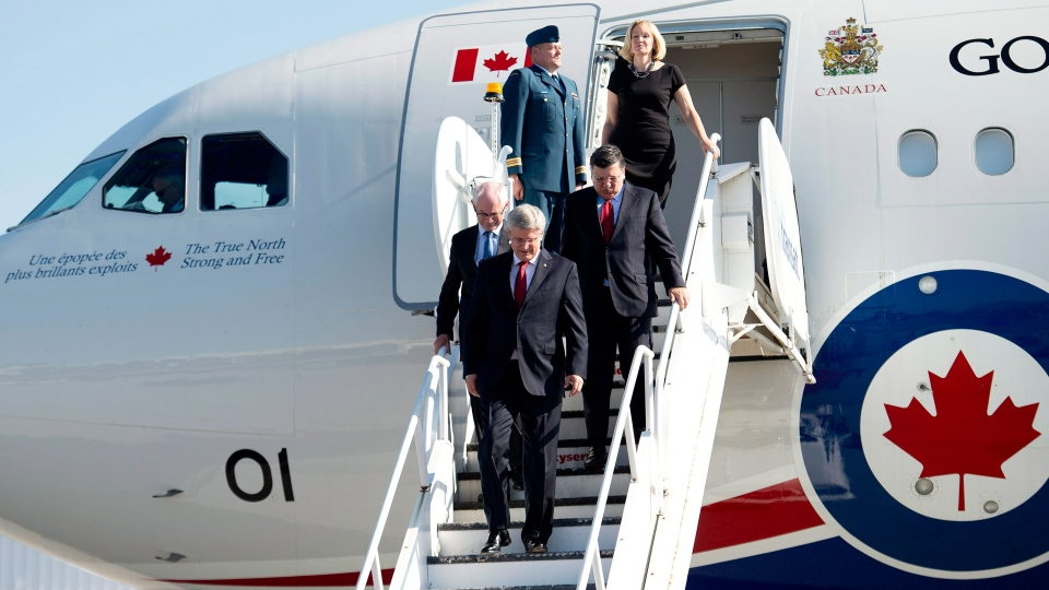 Prime Minister Stephen Harper, centre, arrives with with Herman Van Rompuy, left, President of the European Council, and Jose Manuel Barroso, right, President of the European Commission in Toronto on Thursday, Sept. 26, 2014. (Nathan Denette / THE CANADIAN PRESS)