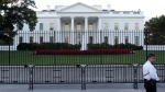 The White House is seen through two layers of fence in Washington, Tuesday, Sept. 23, 2014. (AP / Carolyn Kaster)