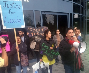 Rocco Trigueros (right), director of the group 'Mexicans Living in Vancouver,' leads a demonstration by concerned immigrant advocates outside the coroners' inquest for Lucia Vega Jimenez in Burnaby, B.C., on Monday, Sept.29, 2014. (Tamsyn Burgmann / THE CANADIAN PRESS)