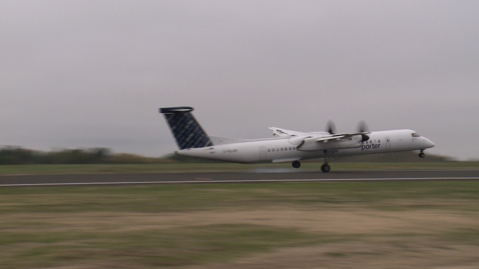 Porter Airlines flight #255 is the first to touch down on the newly rebuilt runway at the Ottawa Airport, Sep. 30, 2014