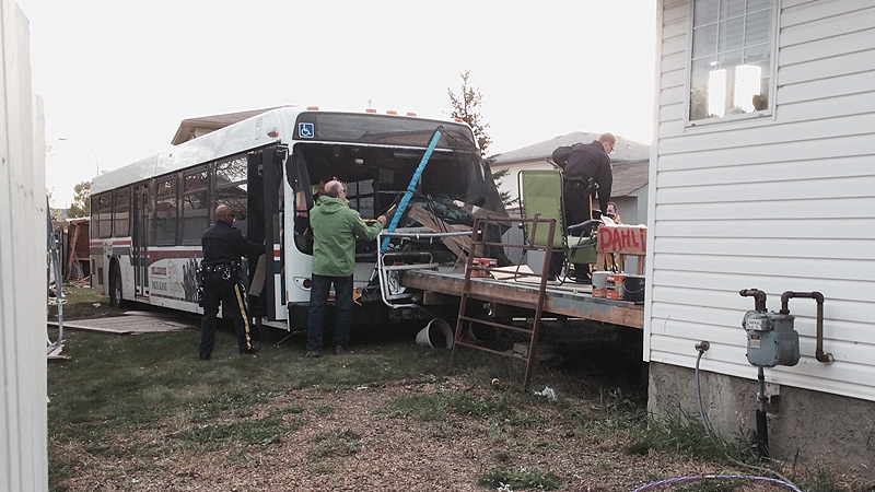 St. Albert RCMP and emergency crews on the scene, after a city bus crashed through two backyards Tuesday, September 30.