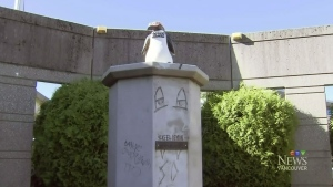 Satan statue replaced by penguin