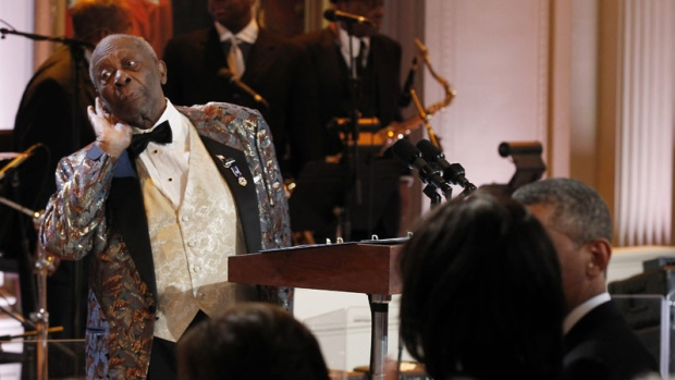 B.B. King, left, performs during the White House Music Series saluting Blues Music in recognition of Black History Month, Tuesday, Feb. 21, 2012, in the East Room of the White House in Washington.