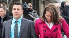 Former hockey player Todd Holt, left, walks out of court with supporters at the Graham James sentencing hearing in Winnipeg, Wednesday, Feb. 22, 2012. (John Woods / THE CANADIAN PRESS)