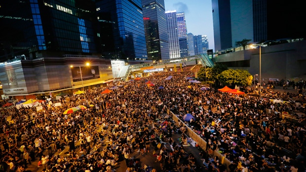 Thousands of pro-democracy activists gather on the streets, Wednesday, Oct. 1, 2014 in Hong Kong. Holiday crowds swelled into the tens of thousands as student leaders met with other pro-democracy protesters Wednesday to thrash out a strategy for handling the government's rejection of their demands that the city's top leader resign and Beijing revise its plans to limit political reforms. (AP Photo/Wong Maye-E)