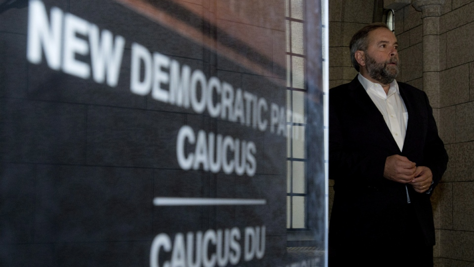 NDP leader Tom Mulcair leaves party caucus to speak with the media on Parliament Hill in Ottawa, Wednesday, Oct. 1, 2014. (Adrian Wyld / THE CANADIAN PRESS)