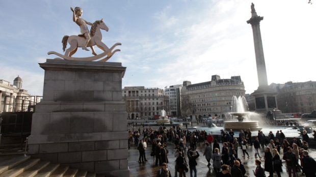 The newly-unveiled sculpture by artist duo Michael Elmgreen, of Denmark, and Ingar Dragset, of Norway, is seen on the Fourth Plinth in central London's Trafalgar Square, Thursday, Feb. 23, 2012. (AP / Lefteris Pitarakis)