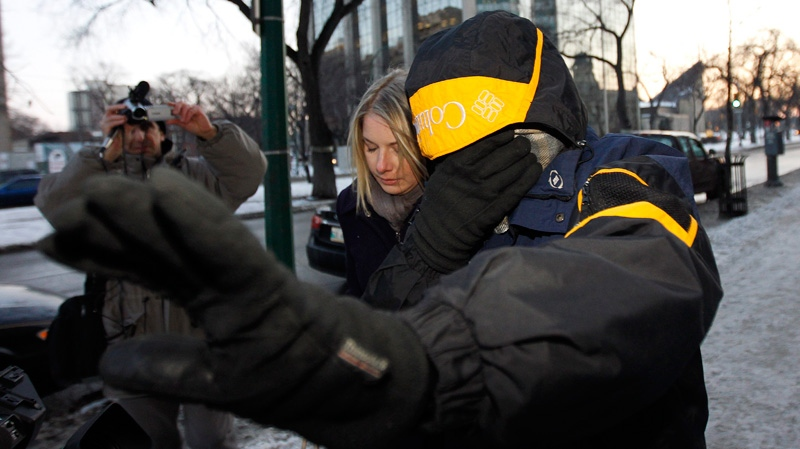 Graham James walks out of a building connected to the Law Courts with an unidentified woman following his sentencing hearing in Winnipeg, Wednesday, Feb. 22, 2012. (Trevor Hagan / THE CANADIAN PRESS)