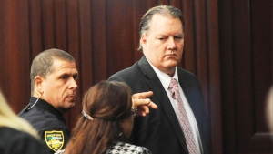 Michael Dunn, right, is directed back to the holding area as he looks at his lawyer Wednesday, Oct. 1, 2014 the Duval County Courthouse in Jacksonville, Fla. (The Florida Times-Union /Bob Mack)
