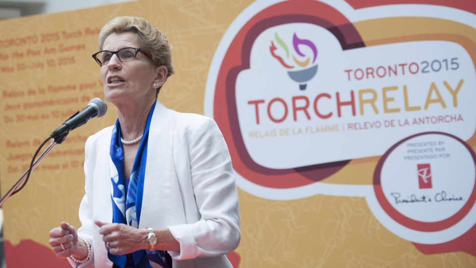 Premier Kathleen Wynne speaks during the announcement of the route for the Toronto 2015 Pan Am Torch Relay at the Eaton Centre in Toronto on Wednesday, Oct. 1, 2014. (Hannah Yoon / THE CANADIAN PRESS)