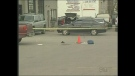 Police tape marks the scene of the shooting death of Thi Tran in London, Ont. on Oct. 11, 2011.
