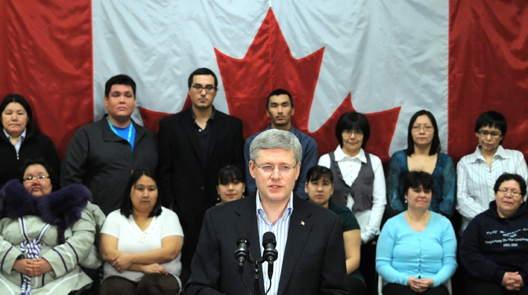 Prime Minister Stephen Harper makes an announcement in front of students at the Nunavut Arctic College in Iqaluit, Nunavut on Thursday, Feb. 23, 2012. (Sean Kilpatrick / THE CANADIAN PRESS)