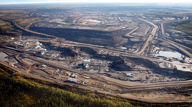 This aerial photo shows a oilsands mine facility near Fort McMurray, in Alberta, Canada. (Jeff McIntosh / THE CANADIAN PRESS)