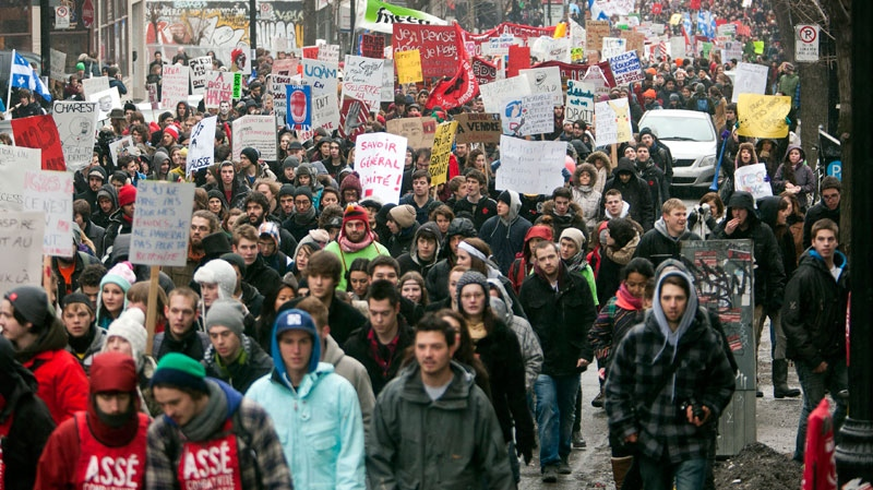 Students march through the downtown streets during a demonstration against higher tuition fees Thursday, February 23, 2012 in Montreal. (Ryan Remiorz / THE CANADIAN PRESS)
