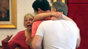Family members of Hannah Witheridge, one of two slain British tourists, at the Royal Thai Police Headquarters in Bangkok, on Sept. 18, 2014. (AP / Sakchai Lalit)