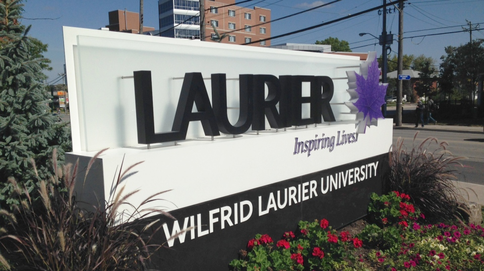 A sign marks the entrance to Wilfrid Laurier University's campus in Waterloo on Wednesday, Sept. 17, 2014. (David Imrie / CTV Kitchener)