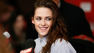Actress Kristen Stewart smiles at the premiere of the film 'Camp X-Ray' during the 2014 Sundance Film Festival in Park City, Utah, Jan. 17, 2014. (Danny Moloshok / Invision)
