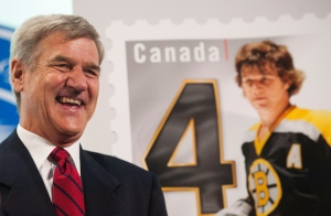 Bobby Orr stands beside his stamp during the unveiling of the NHL stamp series featuring the Original Six Defencemen at the Hockey Hall of Fame in Toronto on Thursday, Oct. 2, 2014. (Hannah Yoon / THE CANADIAN PRESS)