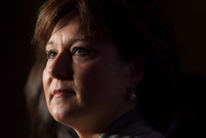 British Columbia Premier Christy Clark listens during a gathering with cabinet ministers and First Nations leaders in Vancouver, on Thursday September 11, 2014. (THE CANADIAN PRESS / Darryl Dyck)