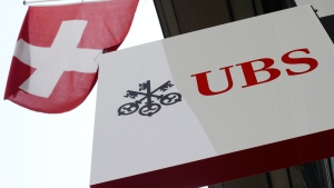 The logo of Swiss bank UBS and the Swiss flag are seen in Zurich, Switzerland, April 24, 2014. (Keystone, Steffen Schmidt)