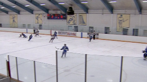 A British Columbia mother says her son's hockey coach hit him in the head.