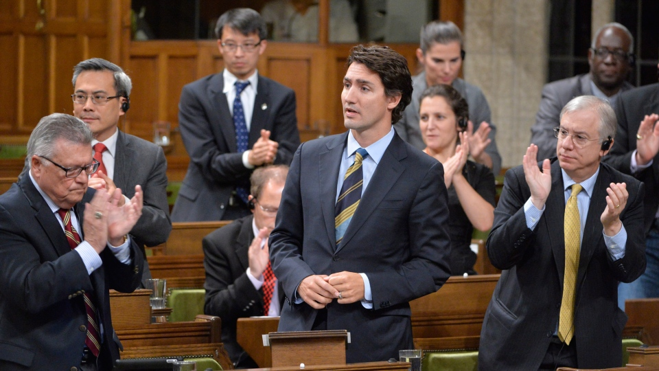 Liberal Leader Justin Trudeau is applauded in the House of Commons on Friday, Oct. 3, 2014. (Adrian Wyld / THE CANADIAN PRESS)