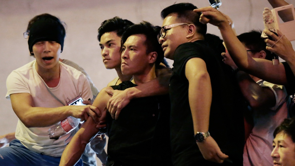 Angry protesters confront each other in Kowloon's crowded Mong Kok district, Saturday, Oct. 4, 2014 in Hong Kong.  (AP / Wong Maye-E)