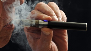 In this Jan. 17, 2014 file photo, a smoker demonstrates an e-cigarette in Wichita Falls, Texas. Soon, the Food and Drug Administration will propose rules for e-cigarettes.  (Wichita Falls Times Record News /  Torin Halsey)