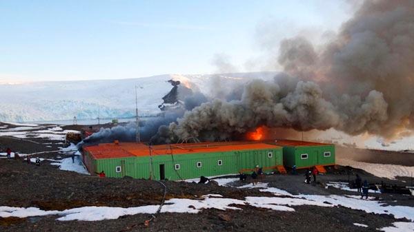 In this photo released by Armada de Chile, fire and smoke rise from Brazil's Comandante Ferraz station in Almirantazgo Bay, in the South Shetland Islands of Antarctica, Saturday Feb. 25, 2012. (AP / Armada de Chile)