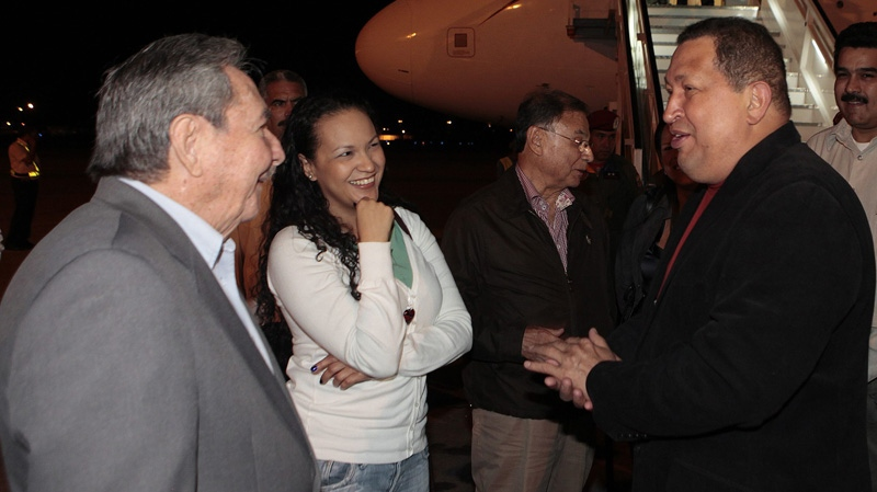 In this photo released by Miraflores Press Office, Venezuela's President Hugo Chavez, right, accompanied by one of his daughters, Rosa, second from left, is welcomed by Cuba's President Raul Castro, left, upon his arrival to Havana, Cuba, Friday, Feb. 24, 2012. (AP Photo/Miraflores Press Office/Marcelo Garcia)
