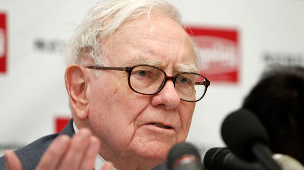 U.S. billionaire investor Warren Buffett, chairman and CEO of Berkshire Hathaway, speaks during a news conference in Iwaki city, Japan, in this Nov. 21, 2011 file photo. (AP / Shuji Kajiyama)