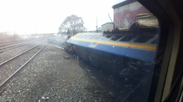 A VIA rail train is shown on its side after it derailed in Burlington, Ont. on Sunday, Feb. 26, 2012.