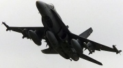 A CF-18 fighter takes off from CFB Trenton in Trenton. Ont., Thursday, Oct. 11, 2001. (Kevin Frayer / THE CANADIAN PRESS)