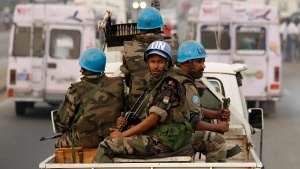 United Nations soldiers from Niger patrol Abidjan, Ivory Coast, on Jan. 10, 2011. (AP / Rebecca Blackwell)