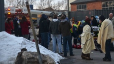 Emergency officials are shown assisting the victims of a VIA Rail train derailment in Burlington, Ont. on Sunday, Feb. 26, 2012. (Andrew Collins)