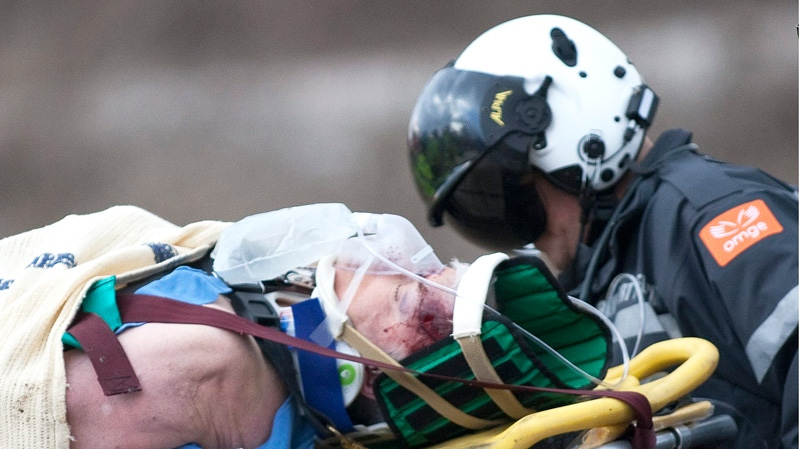 A person injured in the Via Rail passenger train derailment is moved to a Ornge helicopter to be air lifted to hospital in Burlington, Ont. on Sunday, Feb. 26, 2012. (Pawel Dwulit / THE CANADIAN PRESS)